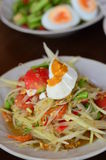 Papaya salad spicy. With egg , somtum stock photos