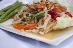 Papaya Salad. Spicy Green papaya salad (somtam) , famous Thai food Royalty Free Stock Images
