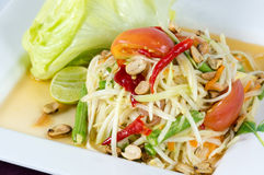 Papaya Salad, Thai call. Som tum the most famous thai salad combination of green papaya, green beans, carrots, garlic, fresh chili, cherry tomatoes and carrots royalty free stock photos