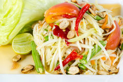 Papaya Salad, Thai call. Som tum the most famous thai salad combination of green papaya, green beans, carrots, garlic, fresh chili, cherry tomatoes and carrots royalty free stock image