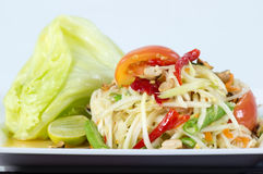 Papaya Salad, Thai call. Som tum the most famous thai salad combination of green papaya, green beans, carrots, garlic, fresh chili, cherry tomatoes and carrots stock image