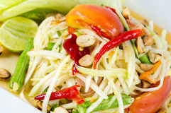 Papaya Salad, Thai call. Som tum the most famous thai salad combination of green papaya, green beans, carrots, garlic, fresh chili, cherry tomatoes and carrots royalty free stock photo