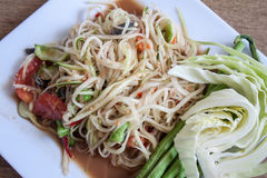 Papaya Salad, Thai call. Som tum the most famous thai salad combination of green papaya, green beans, carrots, garlic, fresh chili, cherry tomatoes and carrots stock photo
