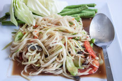 Papaya Salad, Thai call. Som tum the most famous thai salad combination of green papaya, green beans, carrots, garlic, fresh chili, cherry tomatoes and carrots stock photos
