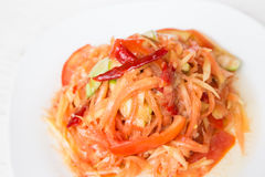 Papaya salad Thai cuisine spicy delicious. With vegetables on white wood background Stock Photography