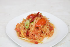 Papaya salad Thai cuisine spicy delicious. With vegetables on wood background Stock Images