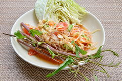 Papaya salad Thai food called Som Tum. Papaya salad on dish Thai food called Som Tum Stock Photos