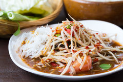 Papaya salad, thai food, som tam. On tre white dish Stock Photos