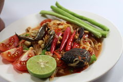 Papaya salad for Thai food. Then Thai language is `SOM THAM THAI POO Royalty Free Stock Photography