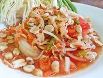 Papaya salad Thai food. On the white dish royalty free stock photography