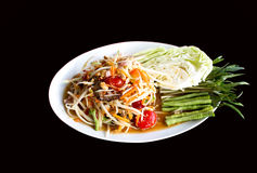Papaya Salad Thai style Som tum serve with fresh grees vegeta. Ble in black background stock photos