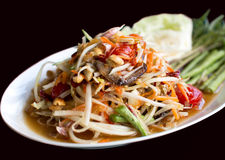 Papaya Salad Thai style Som tum  serve with fresh grees vegeta. Ble in black background Royalty Free Stock Photos