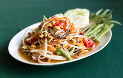 Papaya Salad Thai style Som tum  on the table. Papaya Salad Thai style Som tum  serve with fresh grees vegetable Royalty Free Stock Photos