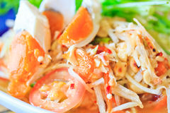 Papaya salad of Thailand. Thai famous food; Papaya salad with salted egg Royalty Free Stock Image
