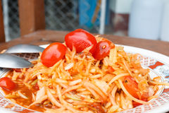 Papaya salad with tomatoes thai  style food. Papaya salad with tomatoes thai style food with wood background Royalty Free Stock Images