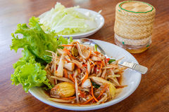 Papaya salad, Traditional spicy Thai food, with sticky rice in w Stock Photography