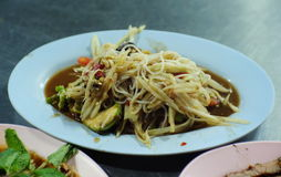 Papaya salad with vermicelli. In the blue plate Stock Photography