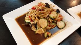Papaya salad is very famous for Thai food. Is sweet sour and spicy stock images