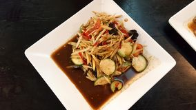 Papaya salad is very famous for Thai food. Is sweet sour and spicy stock image