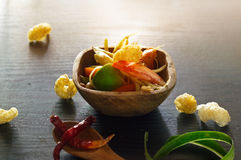 Papaya salad in wood bowl on wooden background, abstract colorful concept Stock Photography