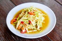 Papaya Salad on Wood Table, Thai cuisine Som Tam a famous Thai f. Papaya Salad on Wood Table, Thai cuisine, Som Tam Malakor, Thai Salad, `Somtum` cuisine Royalty Free Stock Images