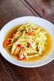 Papaya Salad on Wood Table, Thai cuisine Som Tam a famous Thai f. Papaya Salad on Wood Table, Thai cuisine, Som Tam Malakor, Thai Salad, `Somtum` cuisine stock images