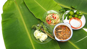 Papaya Slad and Spicy Pork Soup with noodle set on banana leaf Royalty Free Stock Photography