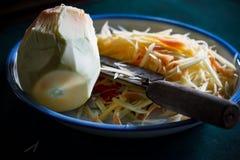 Papaya slice on dish for to do Somtum Thai food. Image dark tone Stock Photo