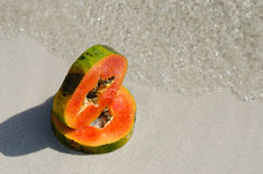 Papaya slice, slice, cut, tropic, fruit, sand water Stock Images
