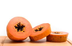 Papaya slice with wooden block isolated Stock Image