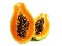 Papaya sliced. Papaya fruit sliced on half isolated on a white background Royalty Free Stock Images