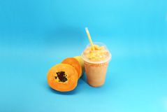 Papaya smoothie. Served in plastic cup and straw Royalty Free Stock Photos