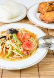 Papaya spicy salad with fried chicken. Papaya spicy salad named Som Tum, Thai food with fried chicken stock photos
