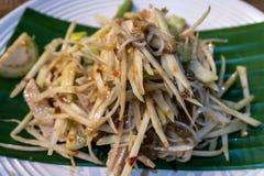 Papaya Spicy salad Most famous of Thai food. Papaya Spicy salad on banana leaf Most famous of Thai food Royalty Free Stock Photo