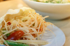 Papaya spicy salad in Thailand. Papaya salad in cabbage or know as Som Tum in Thailand stock photos