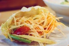 Papaya spicy salad in Thailand. Papaya salad in cabbage or know as Som Tum in Thailand,Vintage tone Stock Image