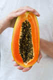 Papaya, tropic fruit, slice, peace, half, hands Royalty Free Stock Photo