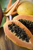 Papaya with tropical background Stock Photos