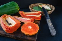 Papaya. Tropical Fruits. On a wooden background stock photography