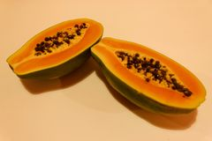 Papaya in two halves stock photography