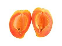 Papaya. Two slices of papaya with seeds Royalty Free Stock Photos