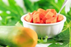 Papaya. On the white background Royalty Free Stock Photo