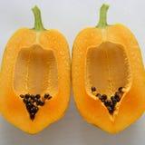 Papaya on white background, tropical fruit Stock Photos