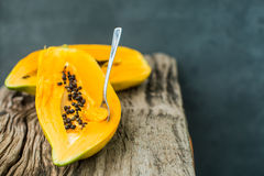 Papaya on the wooden board . Royalty Free Stock Image