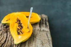 Papaya on the wooden board . Royalty Free Stock Image