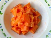Papaya y pasos del corte Fotos de archivo libres de regalías