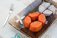 Papayas and dragon fruit on table cloth Royalty Free Stock Photography