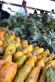 Papayas and Pineapples in Market. Papayas and pineapples are seen in the local market in Villa Nueva, Guatemala. Photo/Carlos Duarte Stock Photos