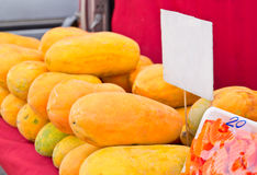 Papayas are sold at an outdoor market Royalty Free Stock Photo