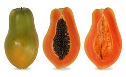 Papayasnitt i halvan av hålet royaltyfri bild